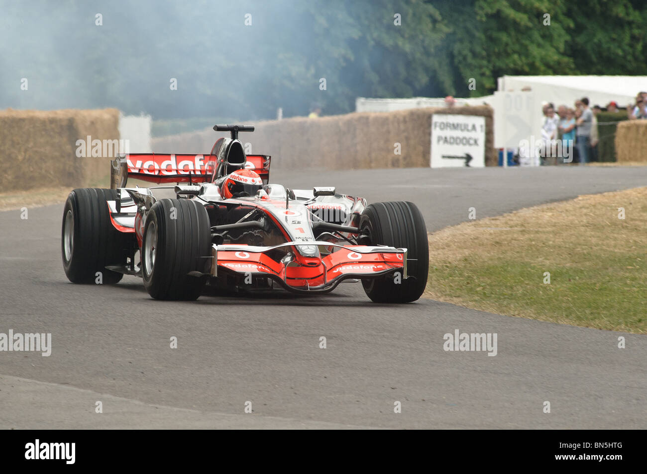 A Maclaren Formula 1 Car climbs the hill at the Goodwood Festival of Speed 2010 - Stock Image