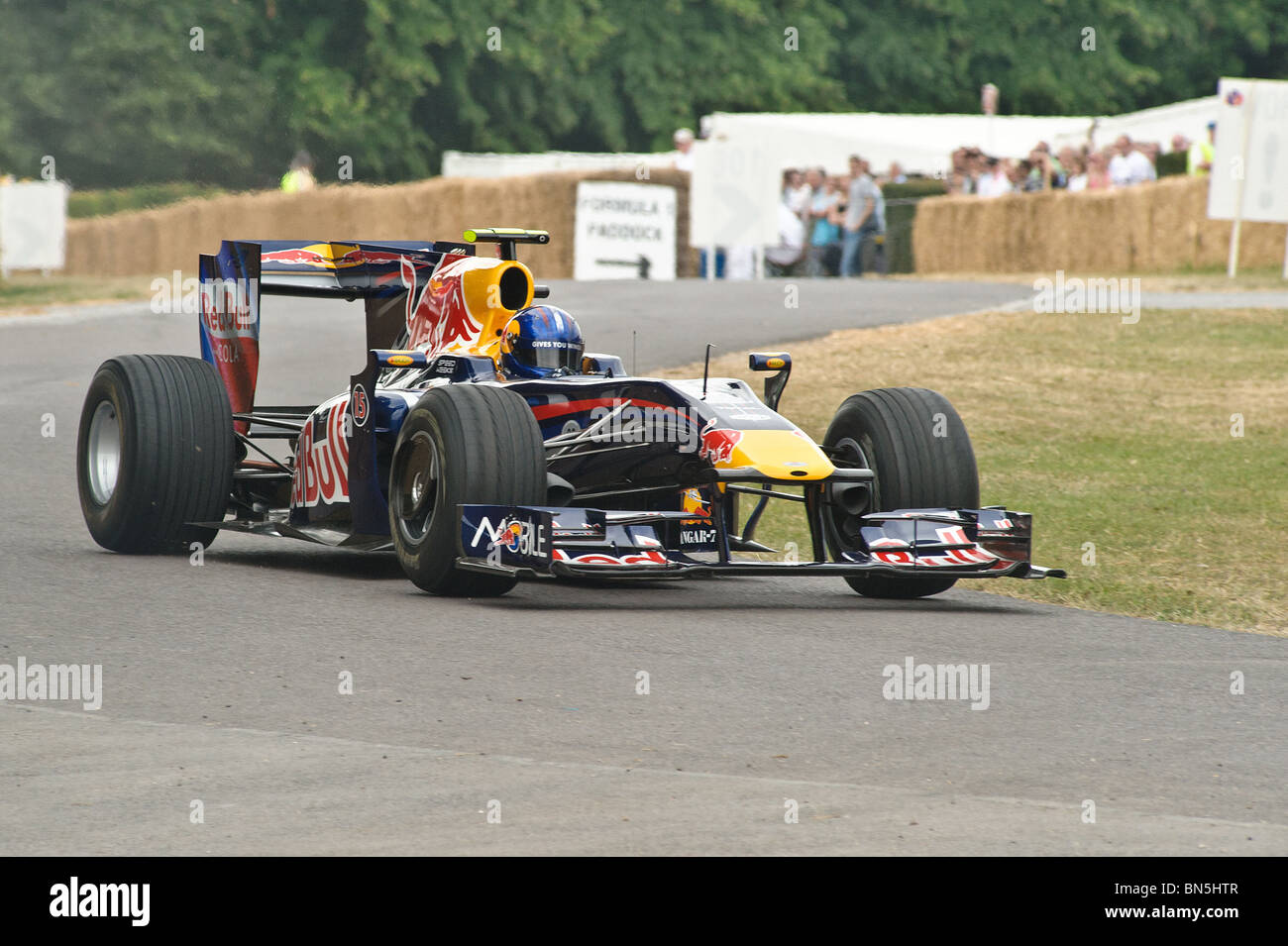 A Red Bull Formula 1 Car Climbs The Hill At Goodwood Festival Of Speed 2010