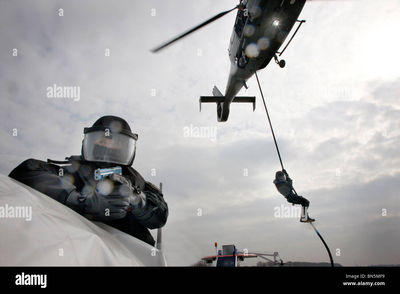 Police SWAT Team at an exercise. Anti terrorism and crime unit, special police forces. Storming a passenger ship - Stock Image