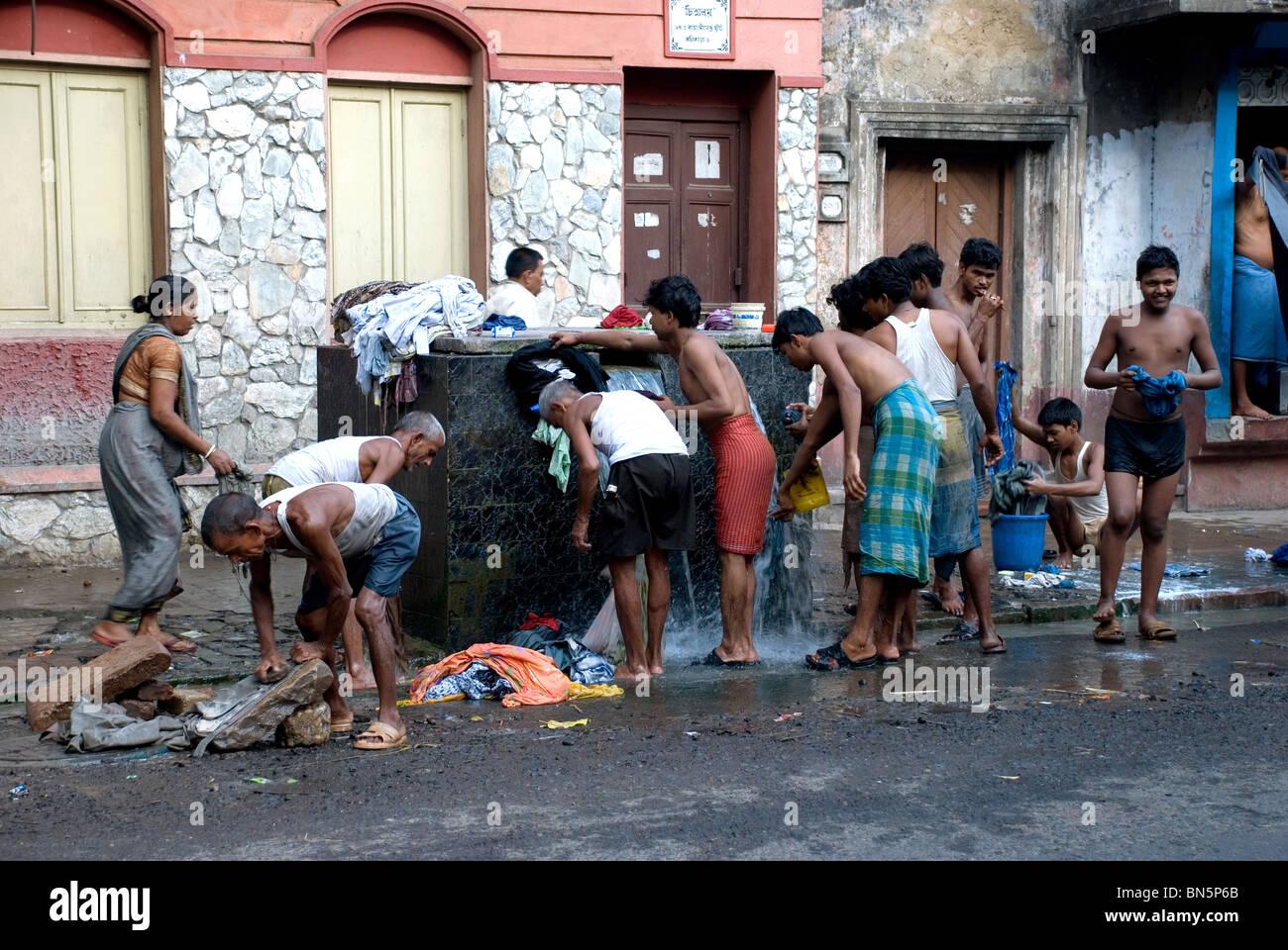 washing on the street calcutta west bengal india - Stock Image