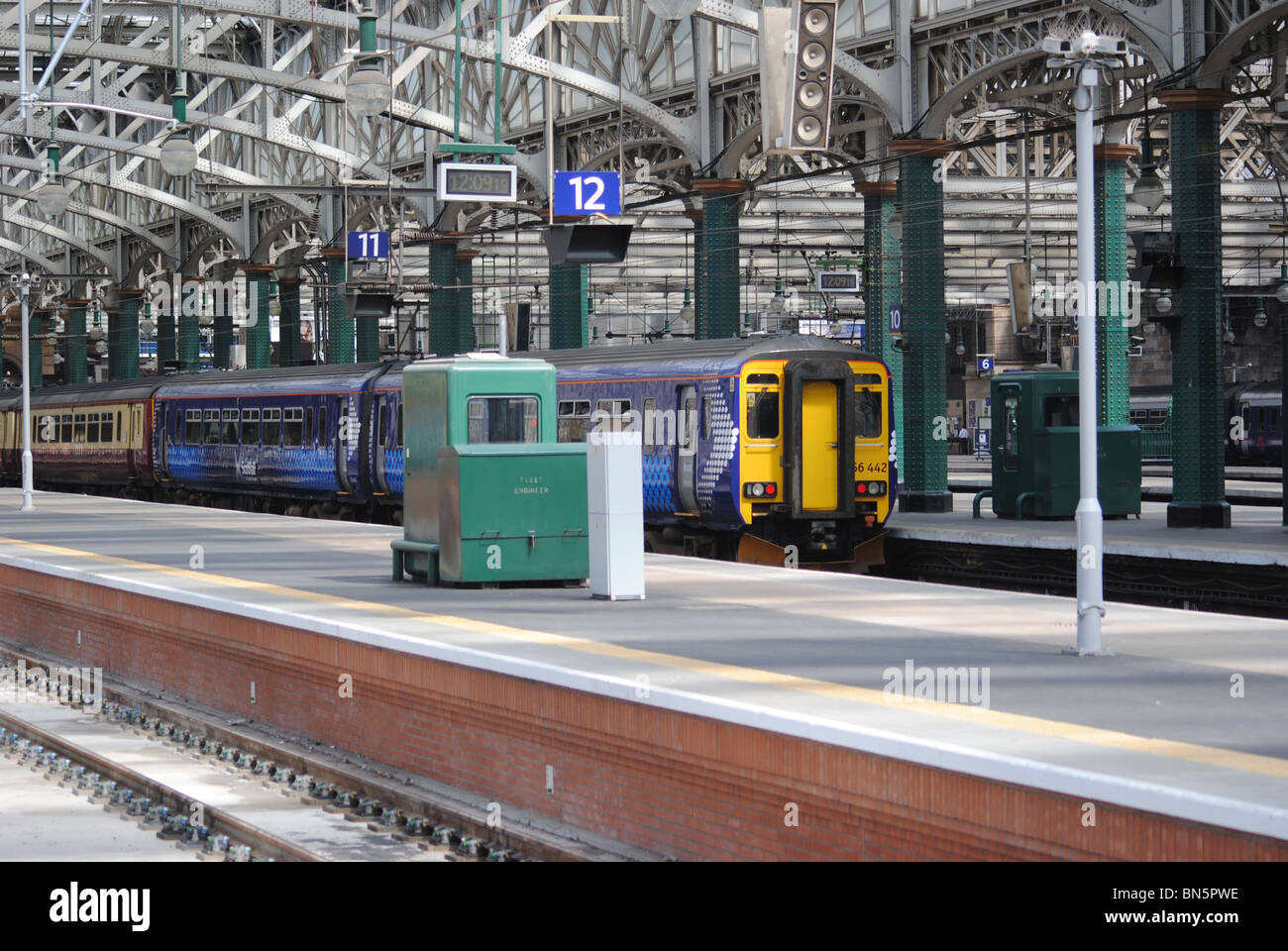 Train arriving at Platform 12 Glasgow Central Railway Station. - Stock Image