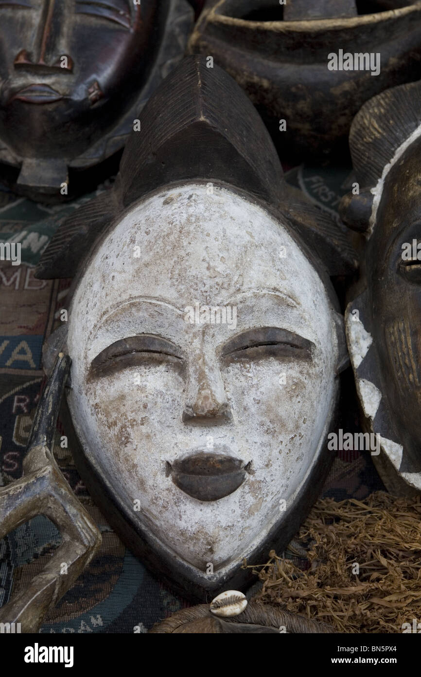 African Masks for sale in front of the Museum of Modern Art in New York City. - Stock Image