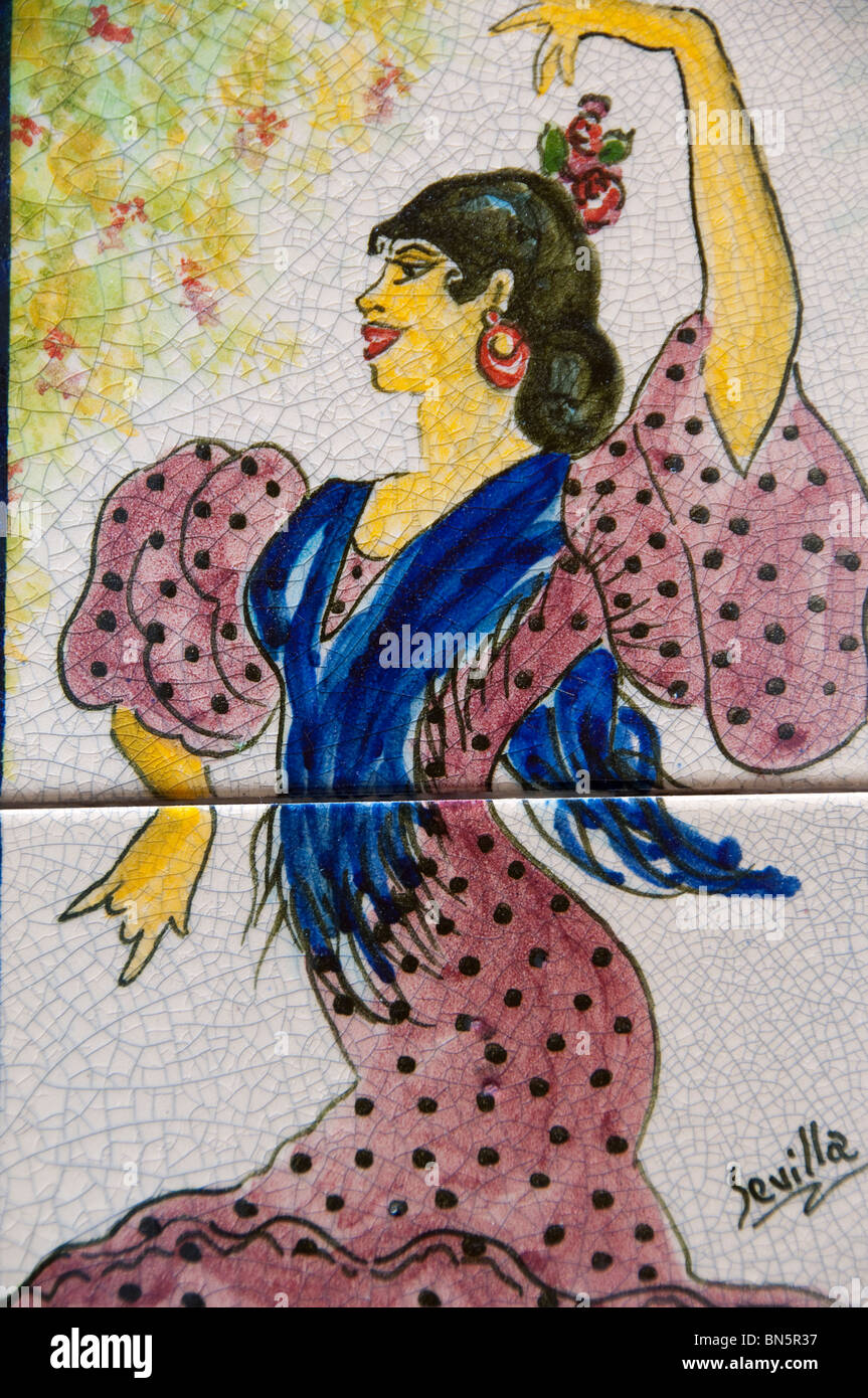 Spain, Cadiz Province, Seville. Historic Santa Cruz District. Typical Spanish hand-painted souvenir tile. - Stock Image