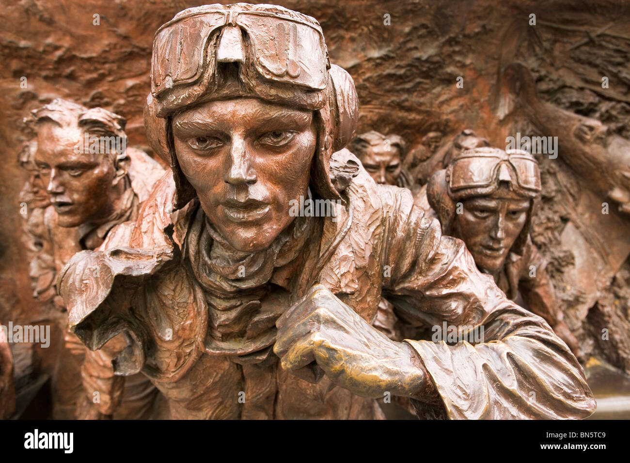 RAF Pilots are depicted on the Battle of Britain Memorial at Embankment in London, England, UK. - Stock Image