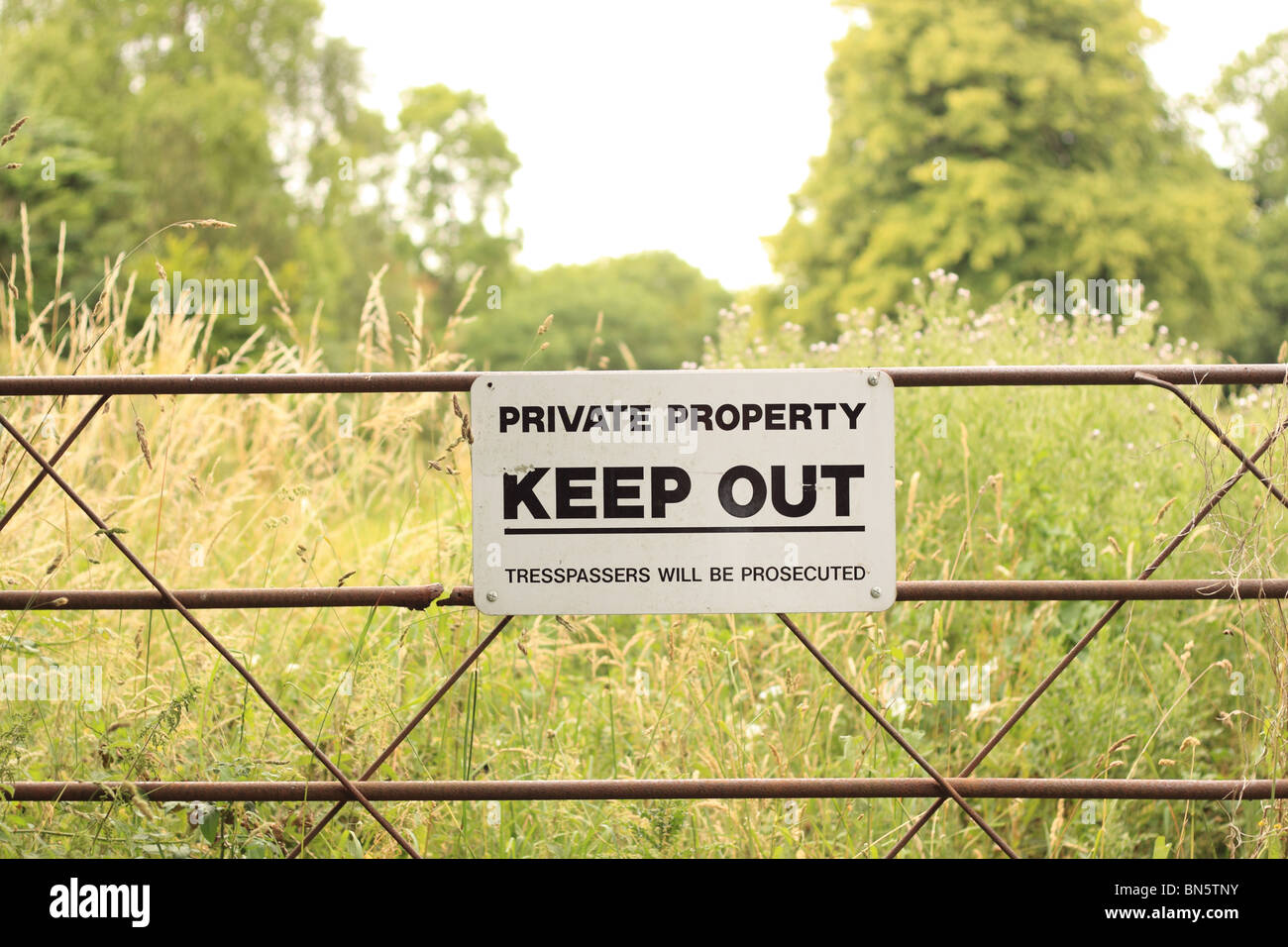 Private Property Keep Out sign trespassers will be prosecuted sign on gate in countryside England UK - Stock Image