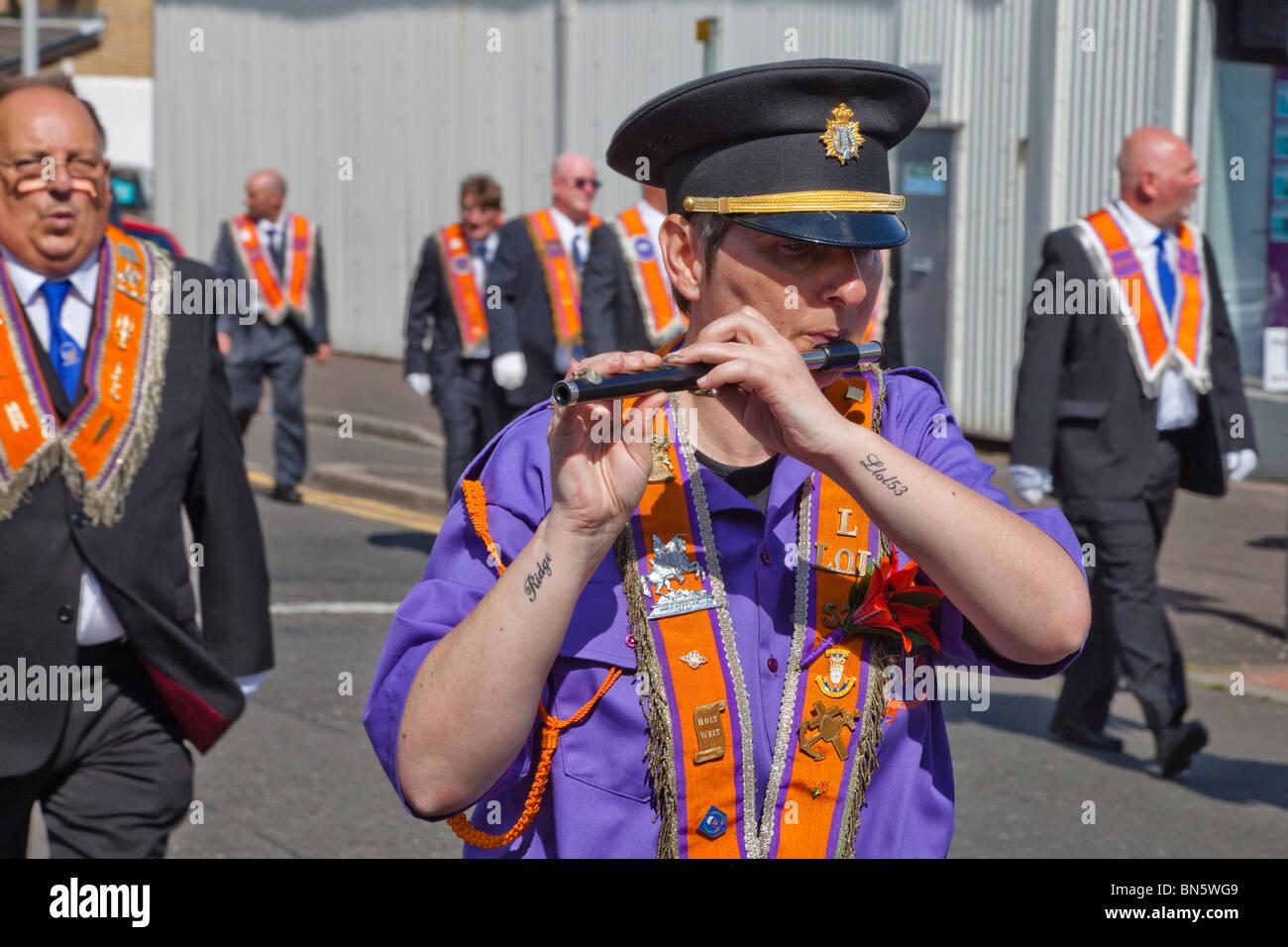 Man playing the flute during an Orange Walk parade, Greenock, Glasgow, Scotland - Stock Image