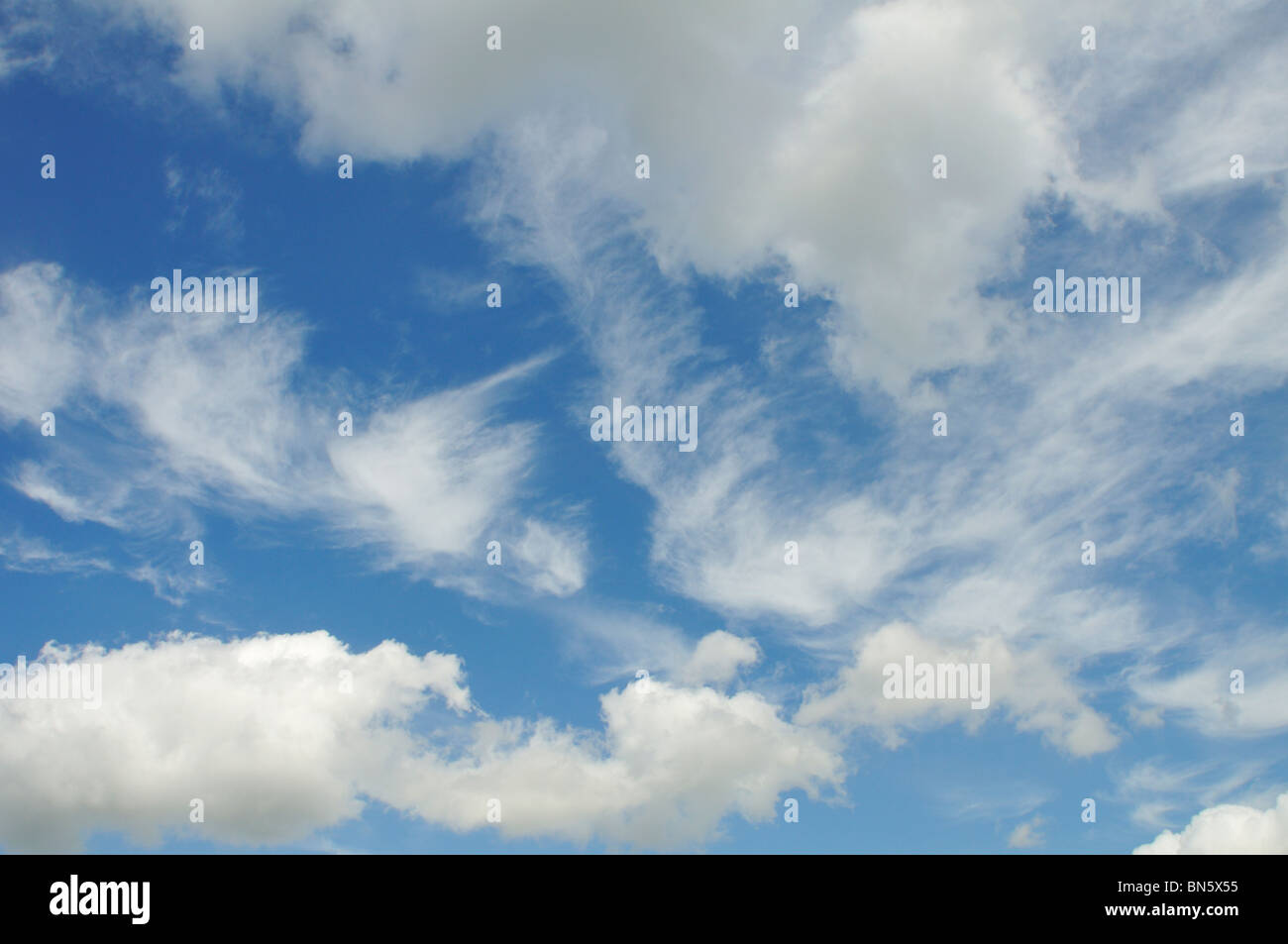 Sunny blue sky with clouds. - Stock Image
