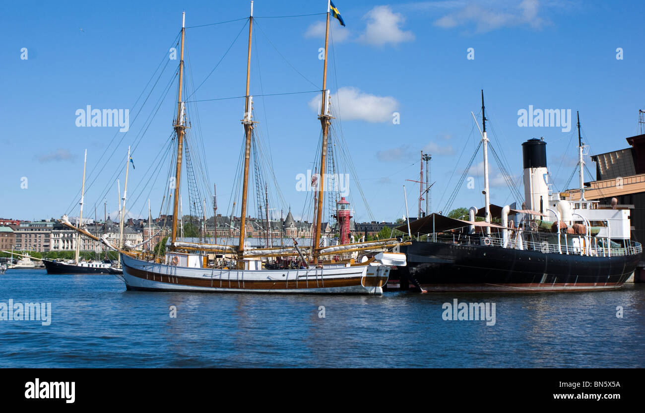 Old steam and sailing ships docked adjacent to the Vasa museum in Stockholm Sweden - Stock Image