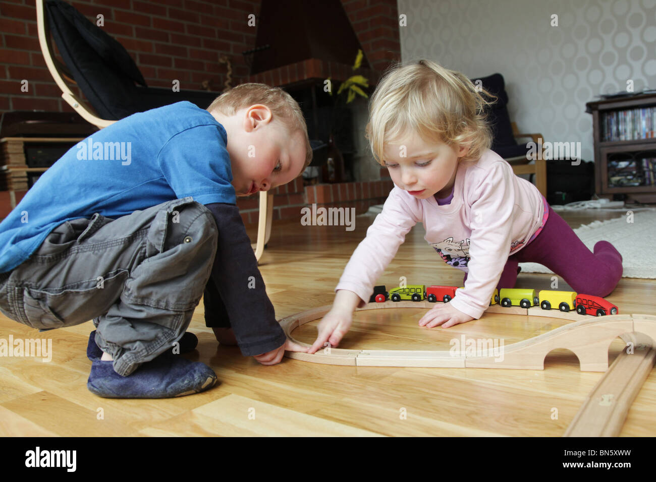 Toddlers Boy Girl Playing Together With A Traditional