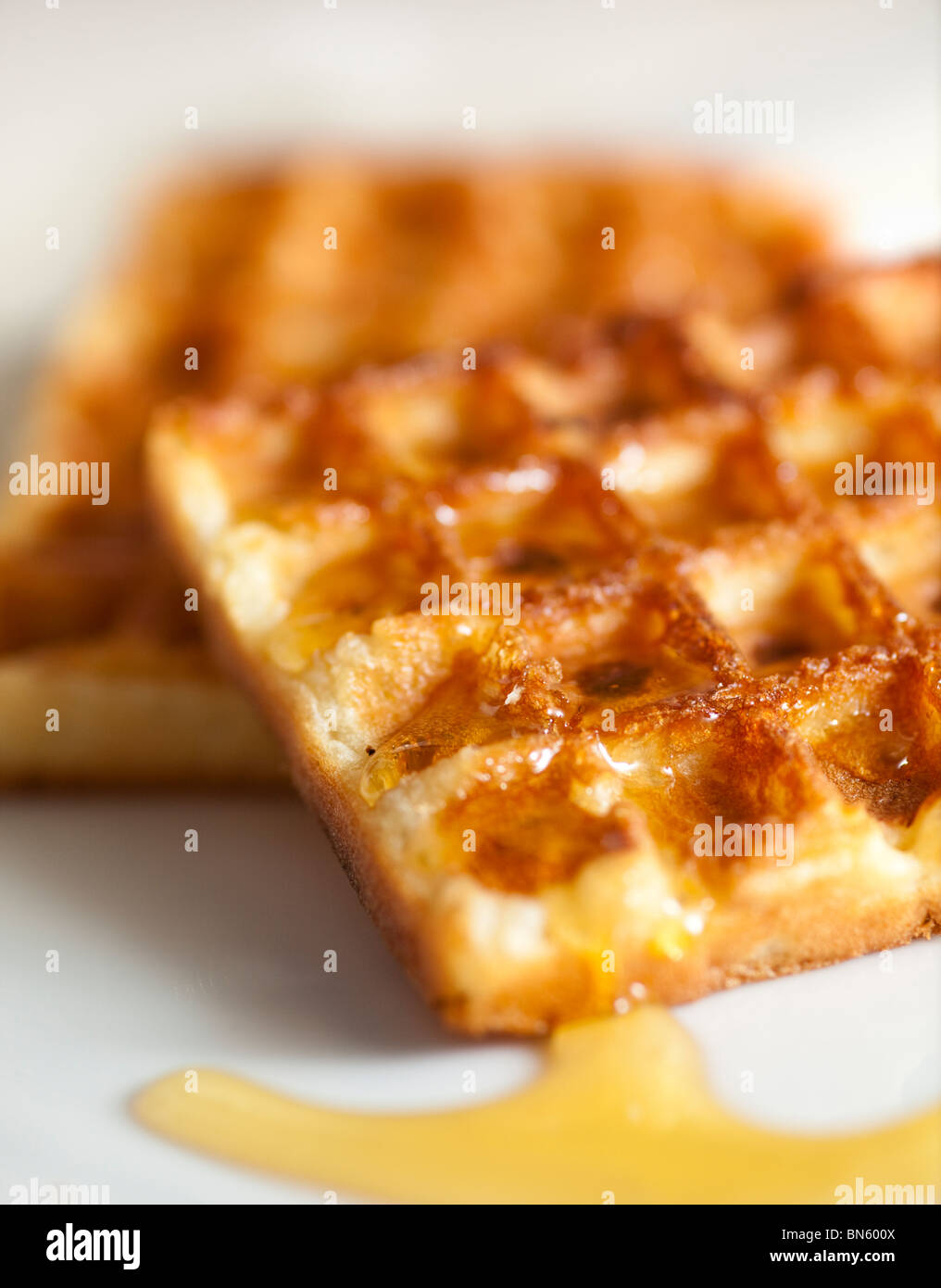 Toasted Waffles with Golden syrup - Stock Image