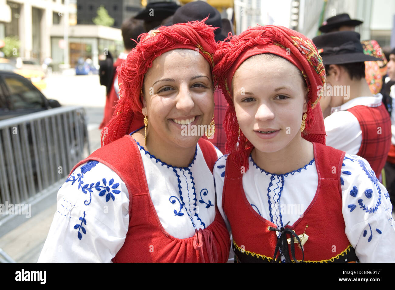 International Immigrants Parade, NYC: Mother and daughter in folk dress representing the Portuguese community in - Stock Image
