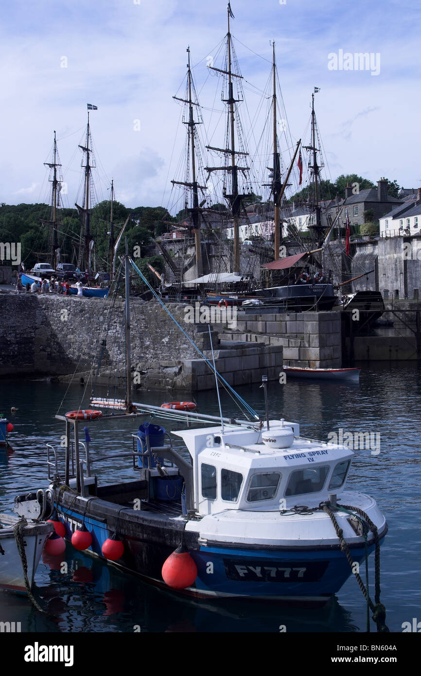 Fishing boat and tall ships in Charlestown Harbour. Cornwall. UK Stock Photo