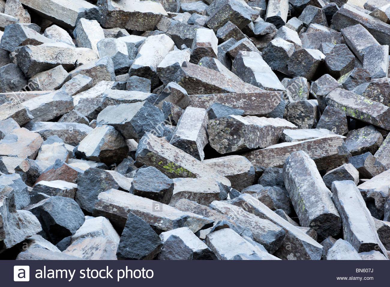 Boulders at Base of Devils Postpile NM, California - Stock Image