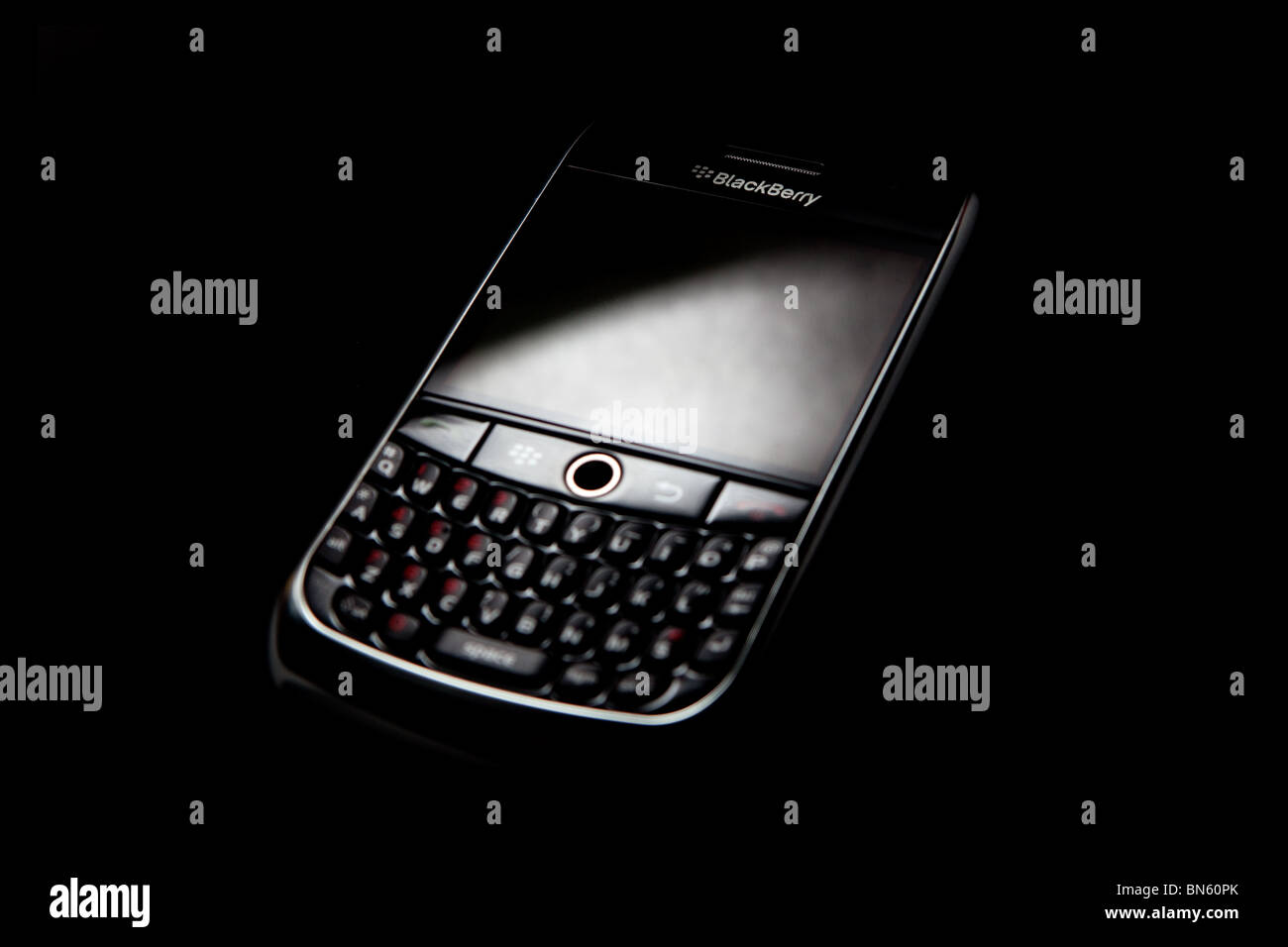 Blackberry 8900 on black background - Stock Image