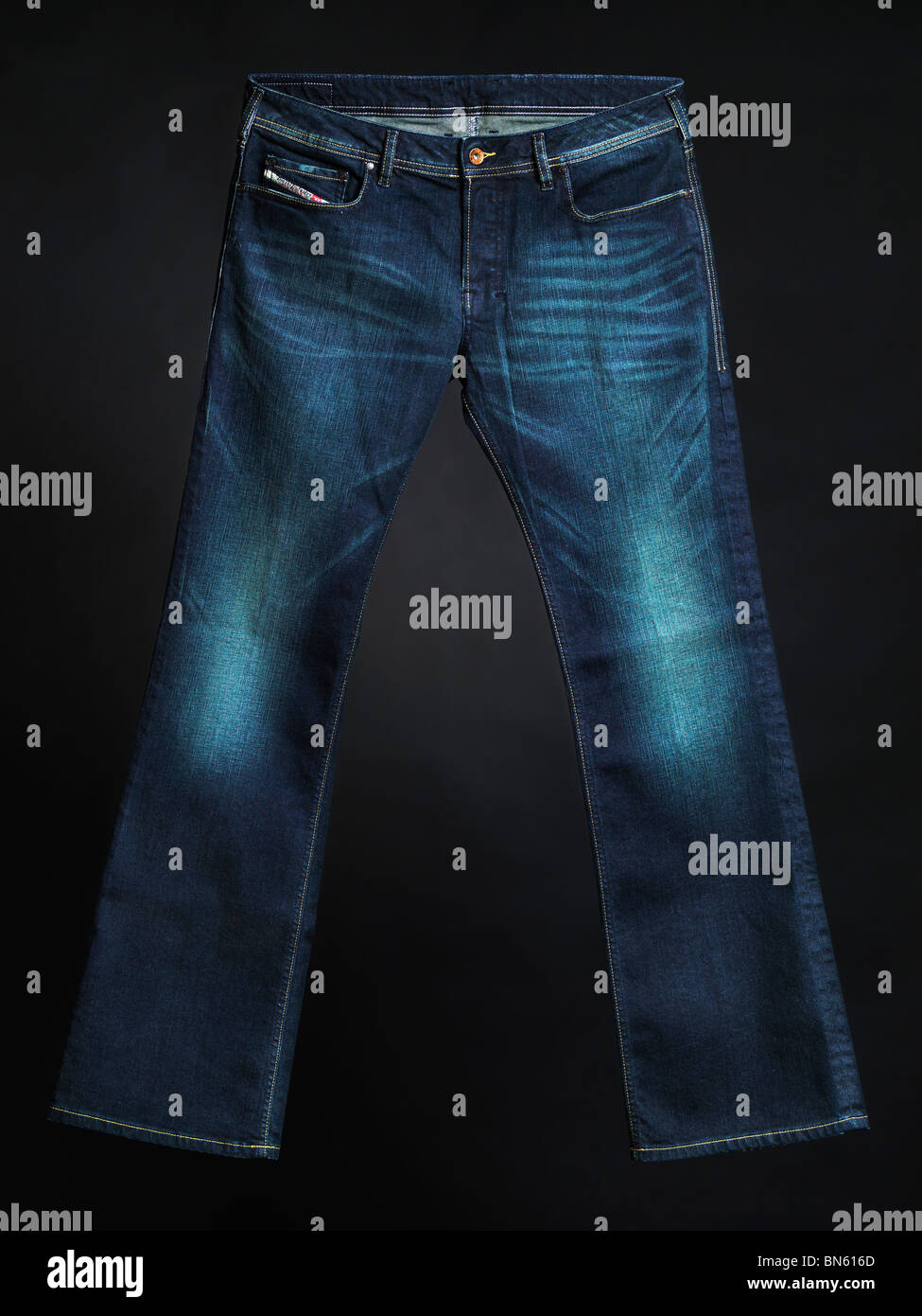 Diesel jeans Zathan. Men boot cut washed denim pants isolated on black background. - Stock Image