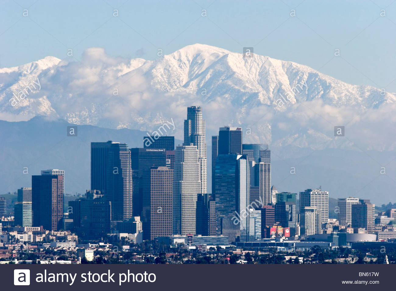 Los Angeles Skyline with Snowy Mount Baldy in Background, California Stock Photo