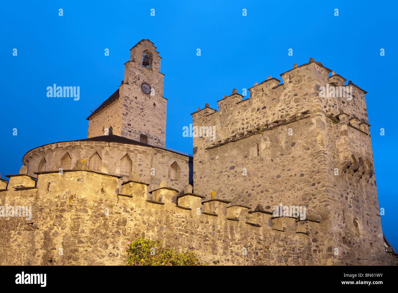 St Andre's Fortified Church illuminated at dusk, Luz-Saint-Sauveur, Midi Pyrenees, France - Stock Image