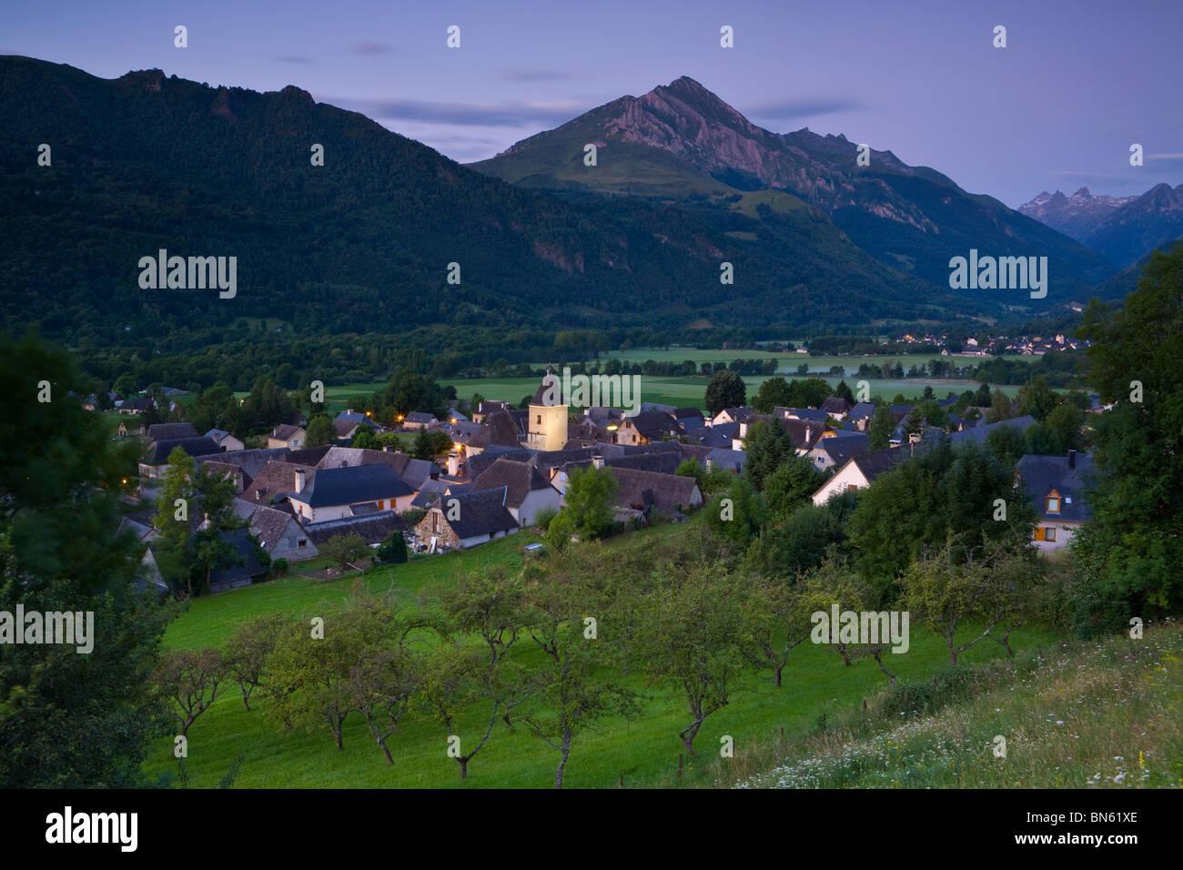 Dawn illuminates the charming Village d'Aucun, Hautes- Pyrenees, France Stock Photo