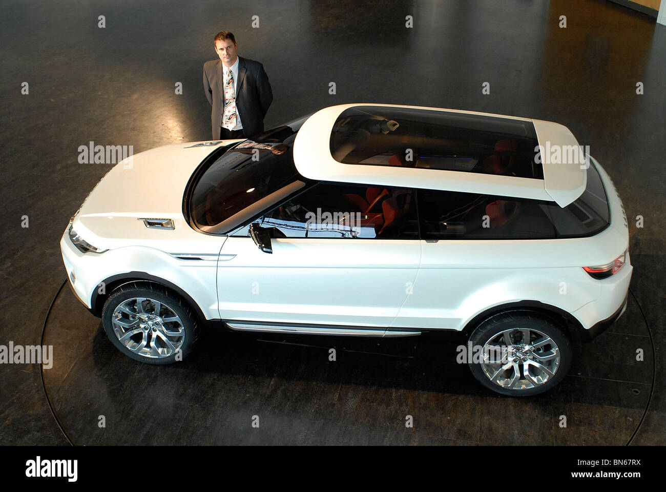 Managing Director Phil Popham with the Land Rover LRX concept car