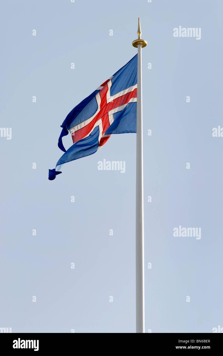 The Icelandic flag flying on a flagpole in Reykjavik, Iceland. - Stock Image