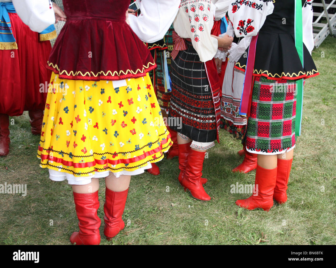 Ethnic skirts and Red boots - Stock Image