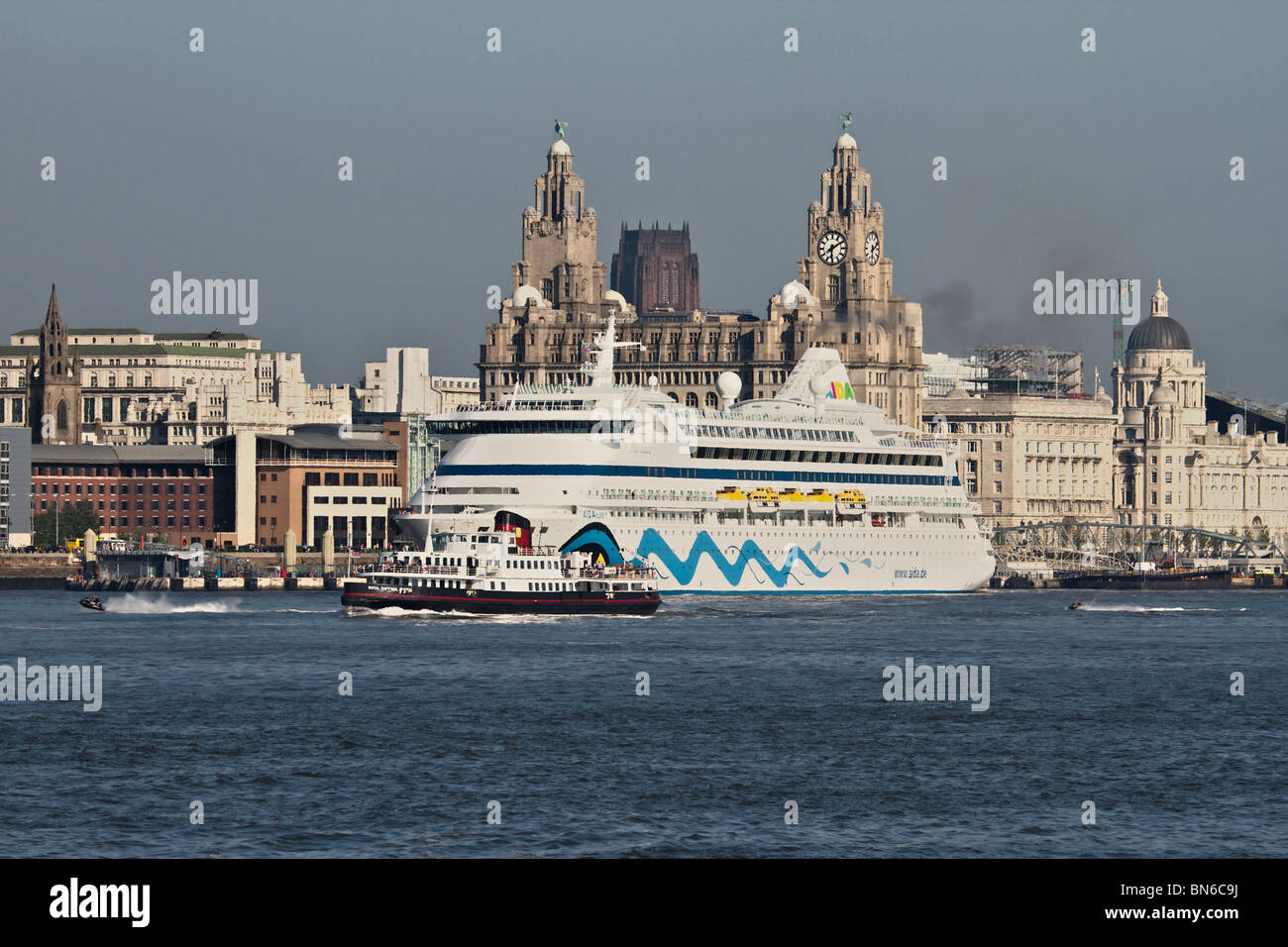 Passenger cruise ship AIDA AURA preparing to to depart after a day visit to Liverpool. - Stock Image
