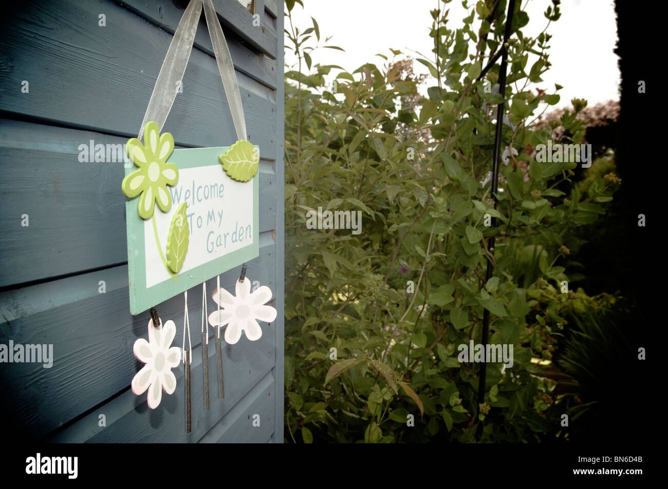 Welcome To My Garden Sign Hanging On Shed