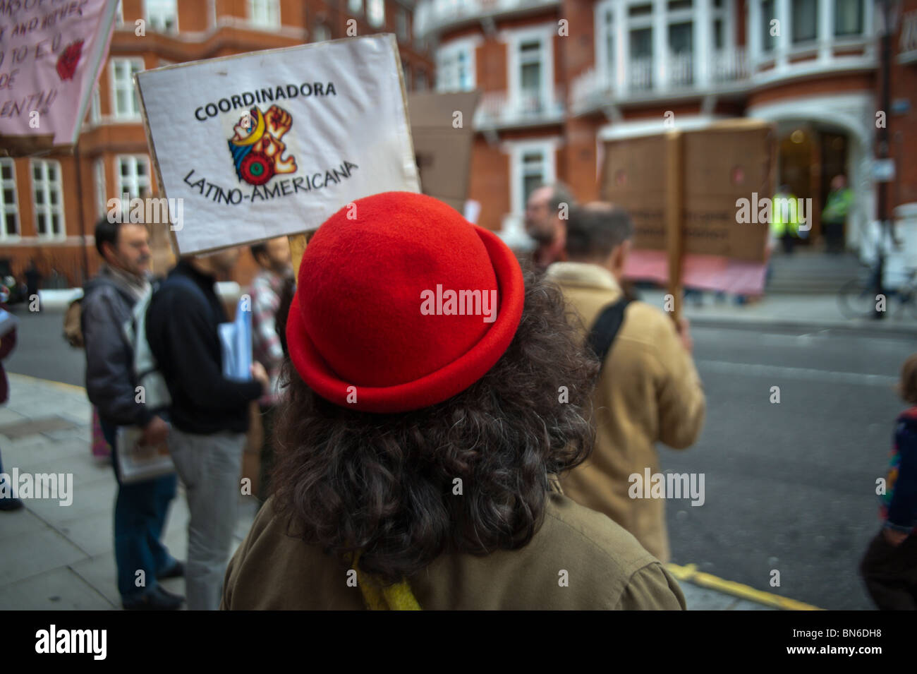 Mobilisation for Mother Earth protesters with placards opposite the Colombian Embassy in London - Stock Image