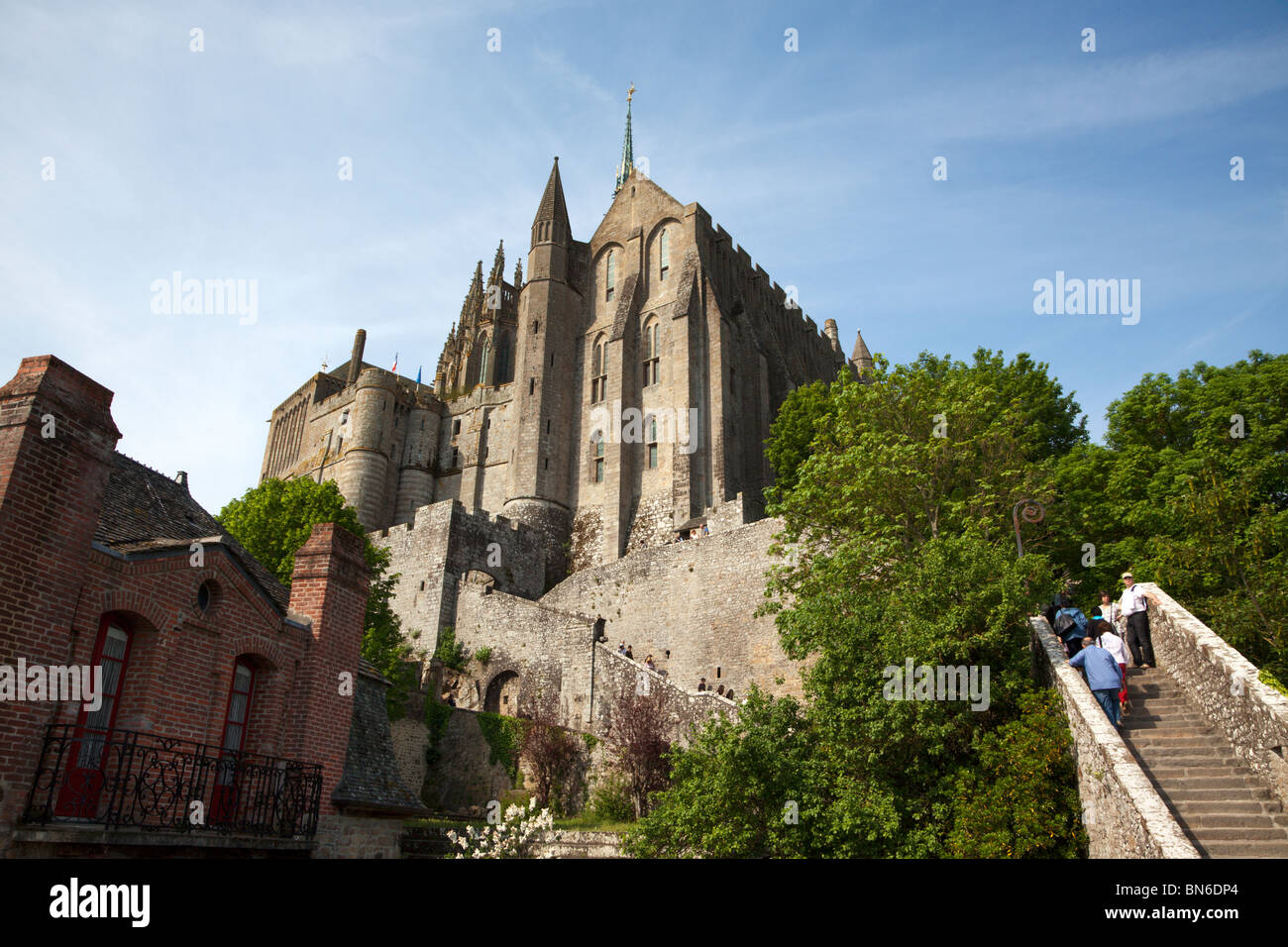 tourists climbing up the stairways to the abbey of St. Michel on the Mont-St-Michel - Stock Image