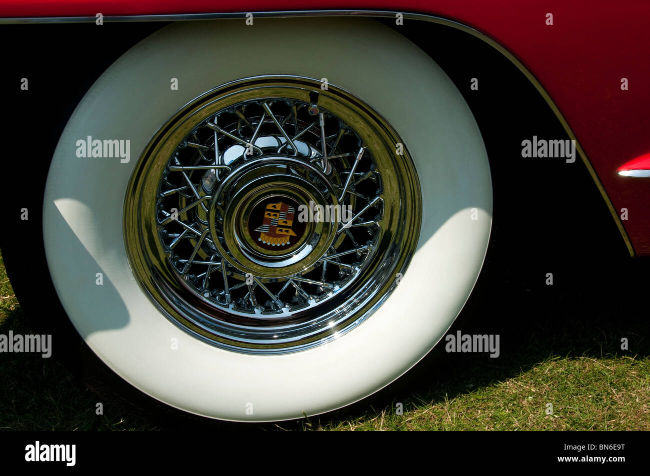 Wheel detail of a classic red Cadillac - Stock Image