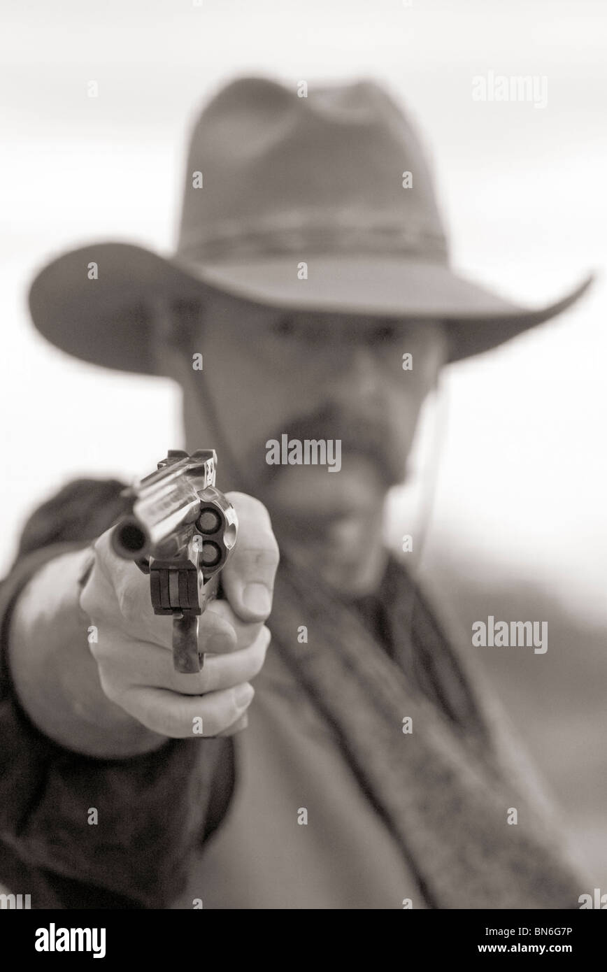 Looking Down The Barrel Of A Gun Of An American Cowboy Stock Photo Alamy