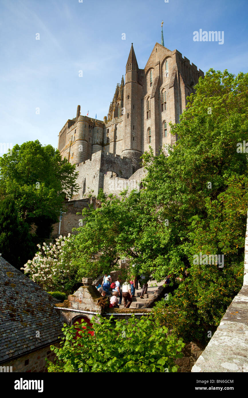 The Abbey of St. Michel on the Mont-St-Michel, tourists climbing up the stairs - Stock Image