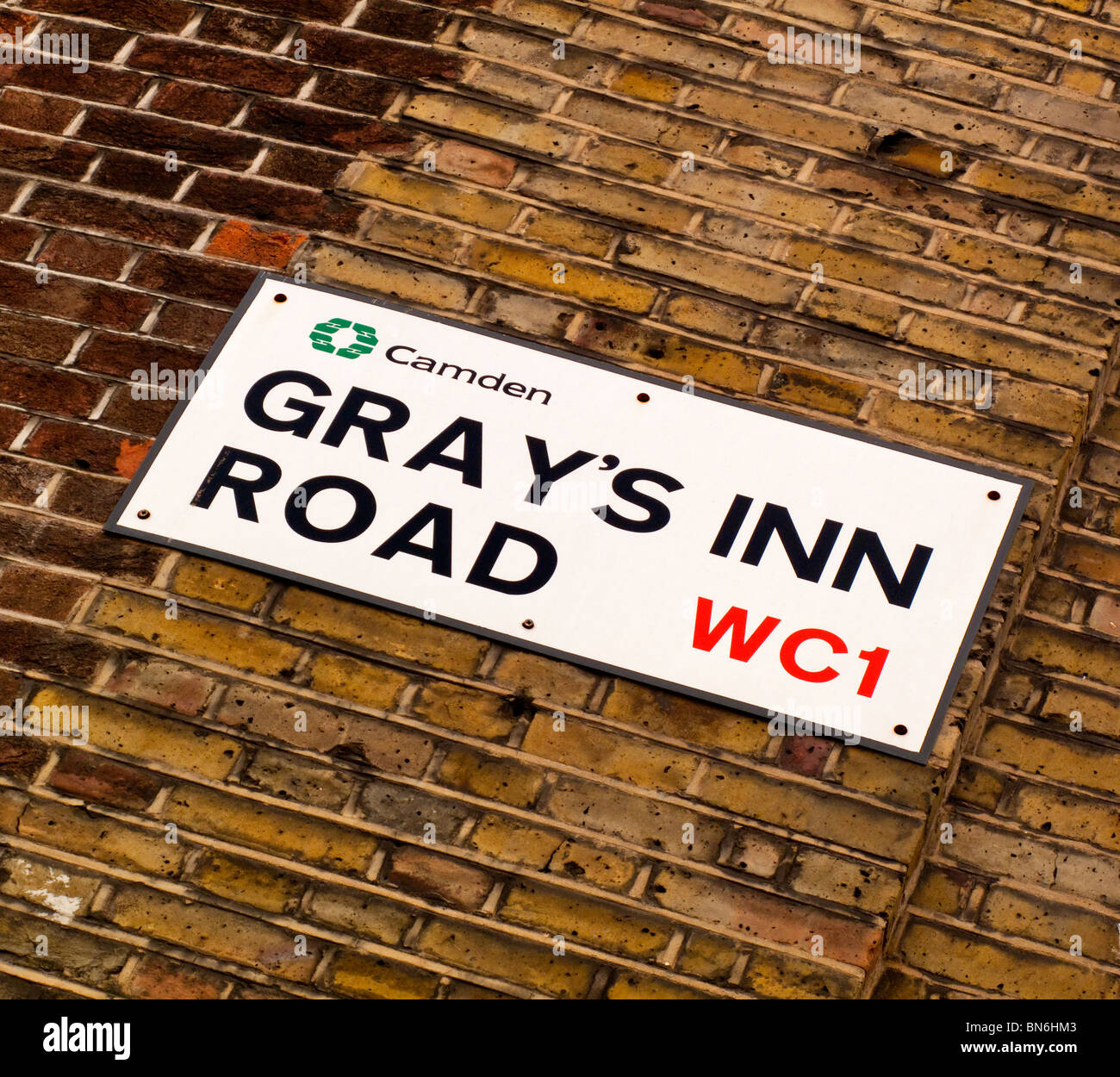 Gray's Inn Road WC1 street sign on a brick wall in King's Cross north London England UK - Stock Image