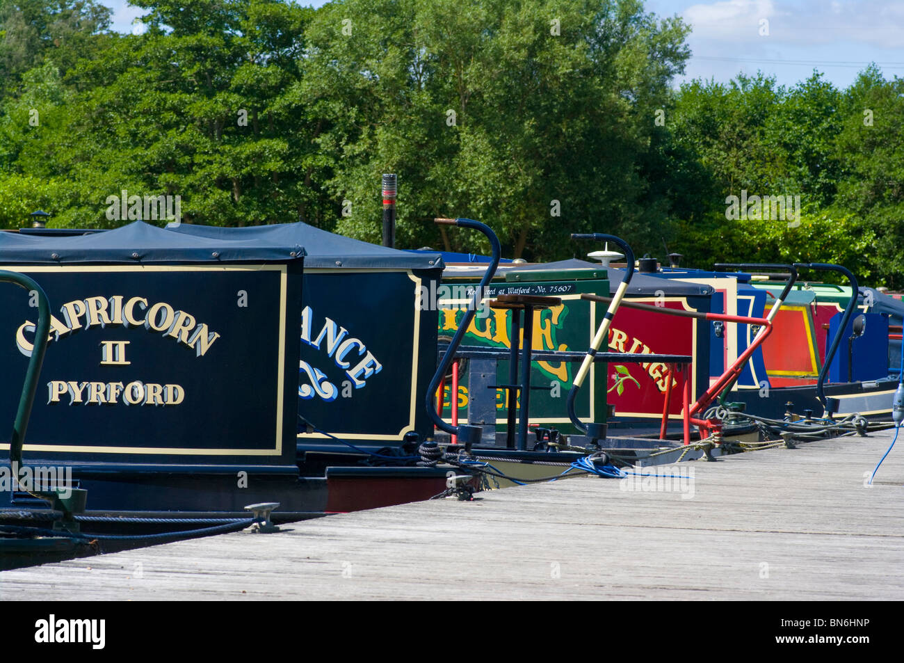Colourful Narrowboat Name Plates and Swans Neck Tillers - Stock Image