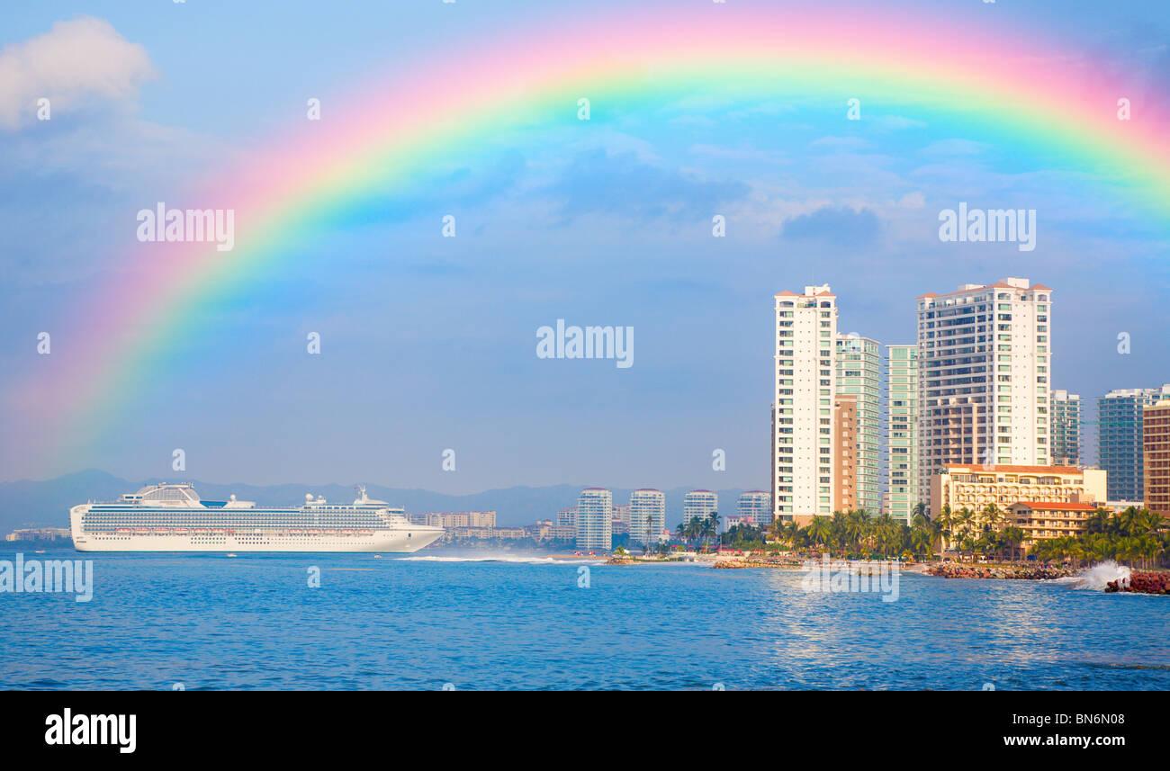 Rainbow over shoreline of Puerto Vallarta - Stock Image