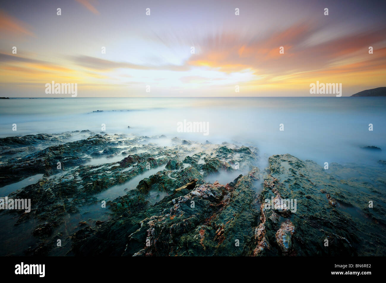 Moody seascape at sunset - Stock Image