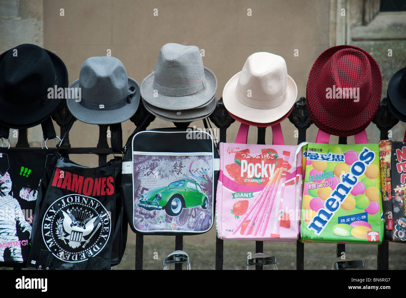44478b9f51e927 Hats and bags, for sale hanging on a fence on a market stall in Cambridge UK