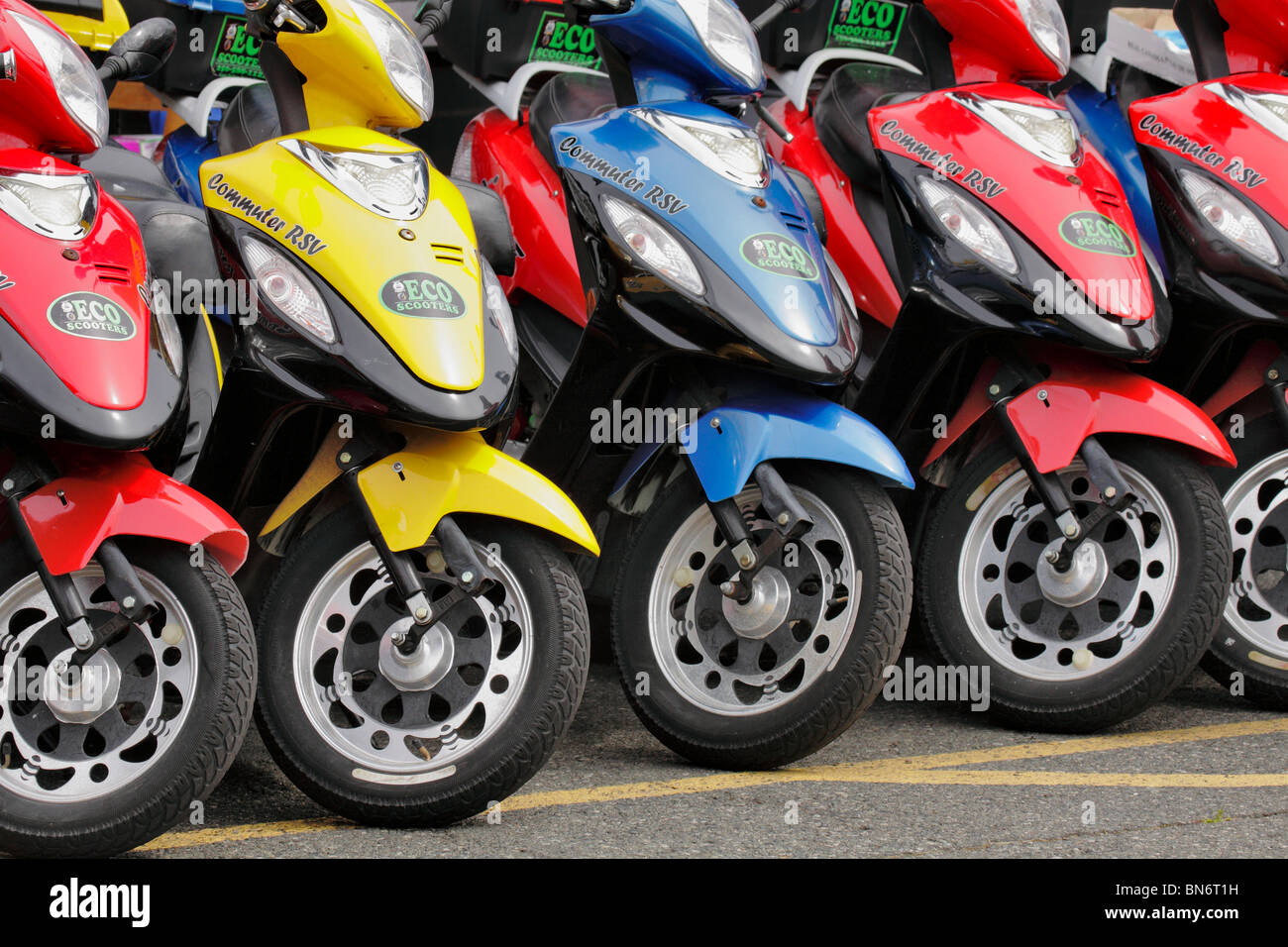 Rental Scooters lined up ready for usage-Victoria, British Columbia, Canada. - Stock Image