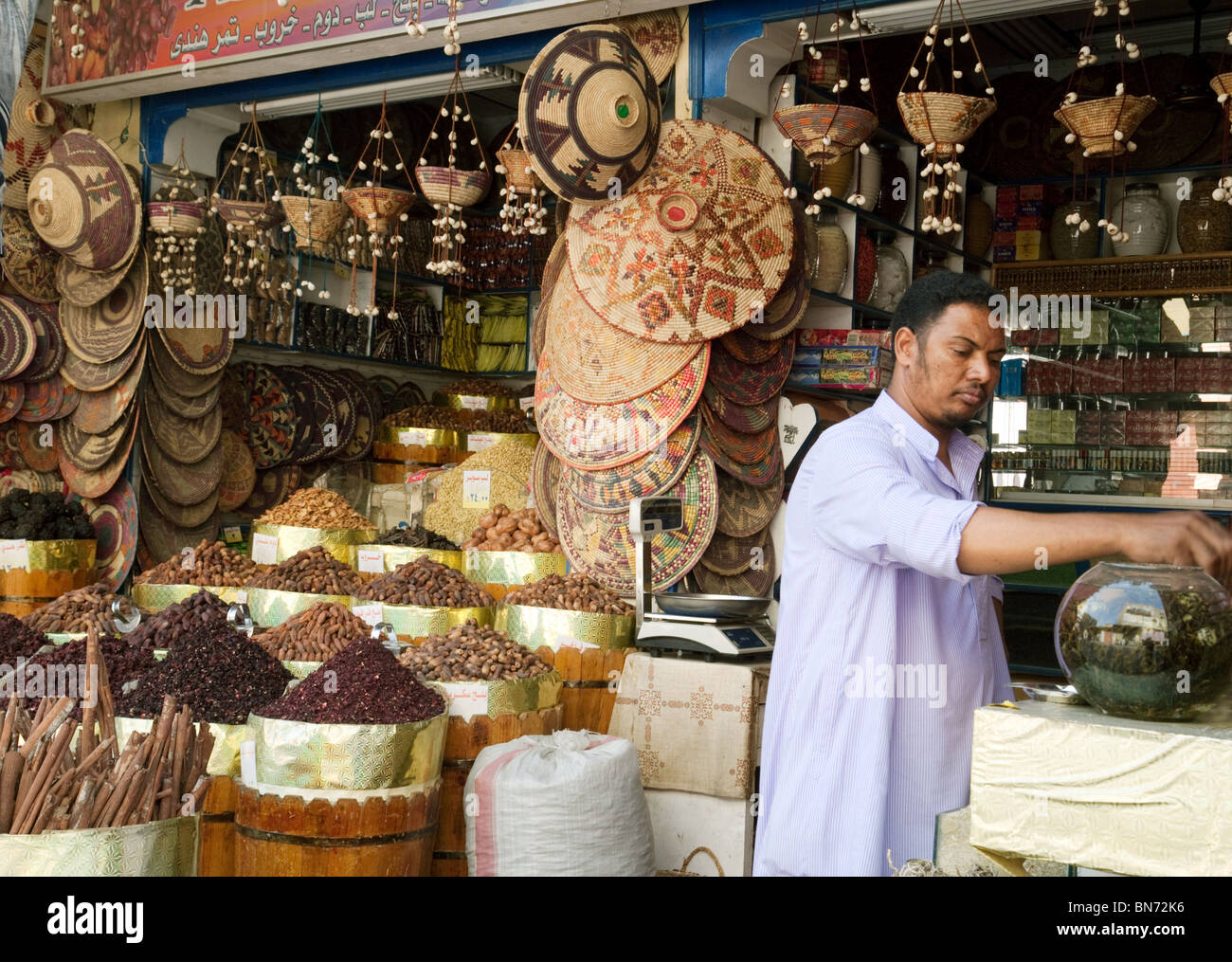Spice merchant in his store, The market, Aswan, Upper Egypt - Stock Image