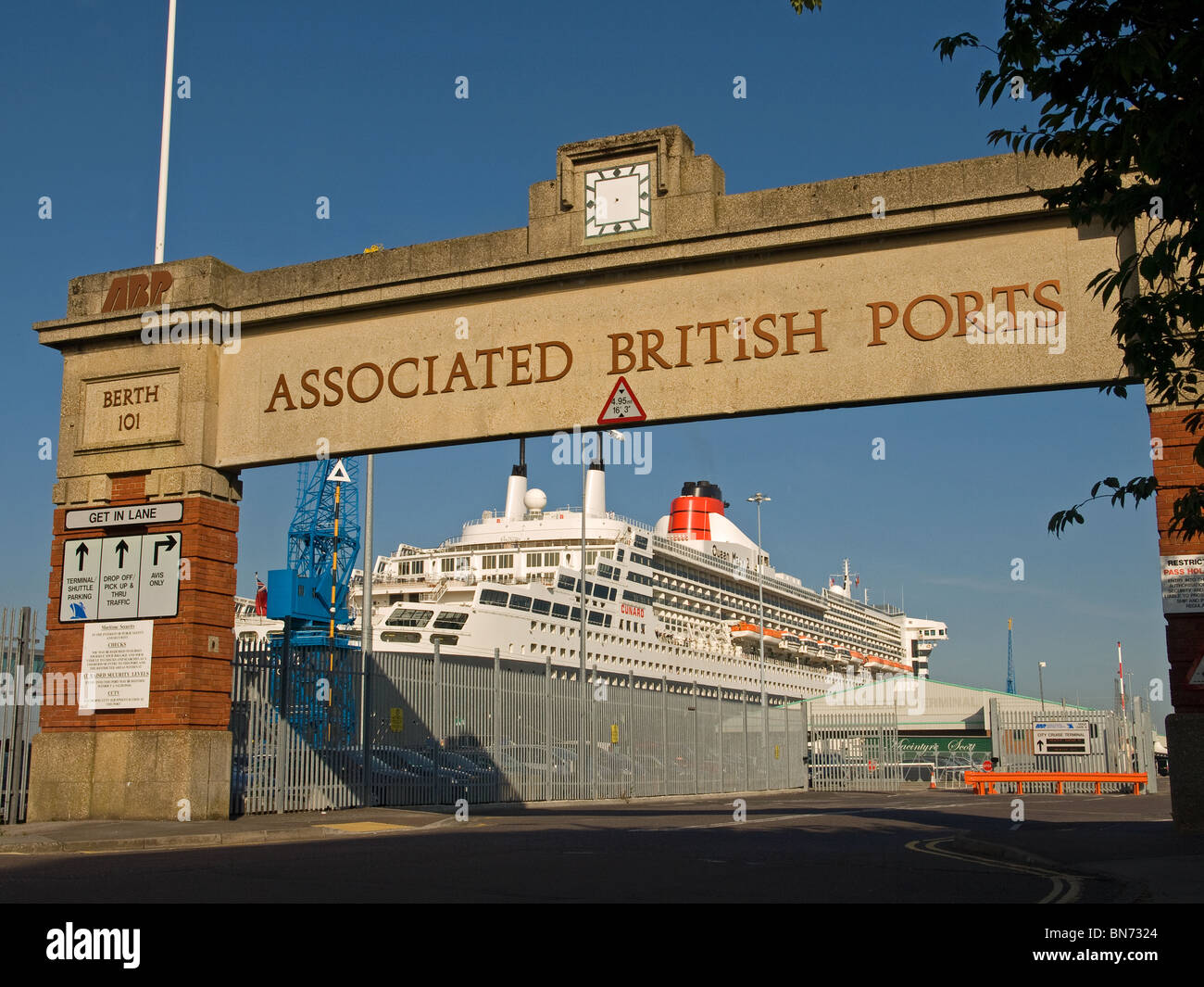 Berth 101 entrance to Associated British Ports Southampton England UK with Cunard's ocean liner Queen Mary 2 - Stock Image