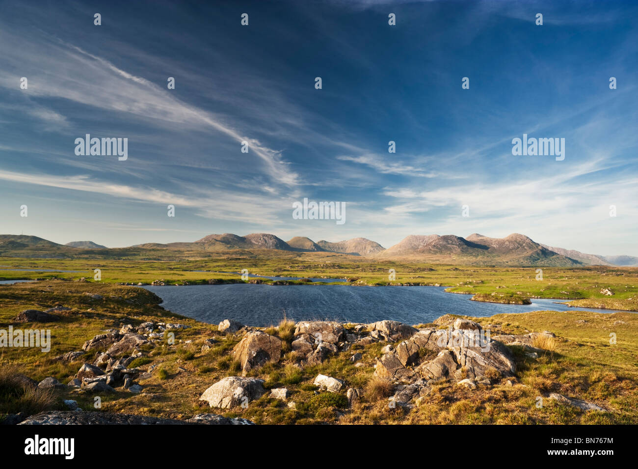 Lake at Arkeen More, overlooking the Twelve Bens mountain range, Connemara, County Galway, Ireland - Stock Image