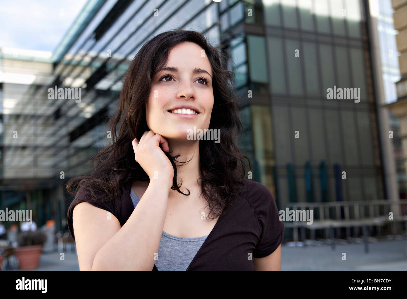 Young woman looking interested - Stock Image