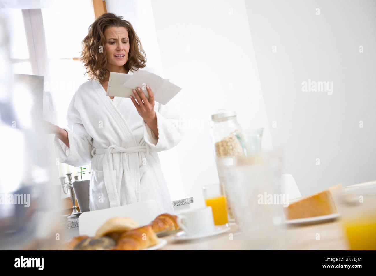Woman getting bad news - Stock Image