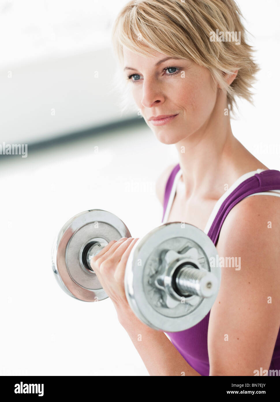 Woman with dumbbell training triceps - Stock Image