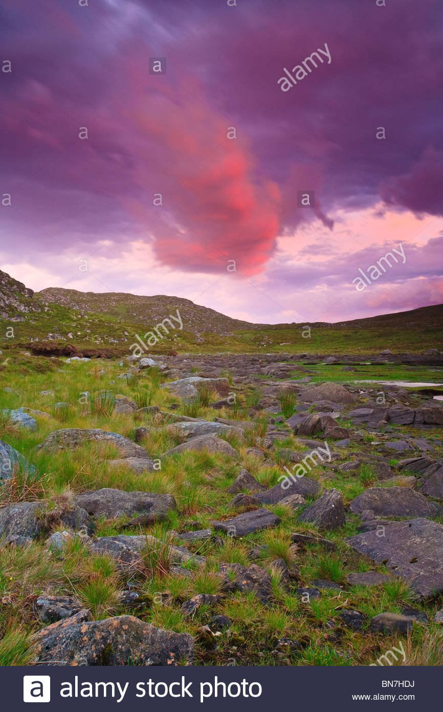Colorful skies above the island Runde in the western part of Norway. Stock Photo