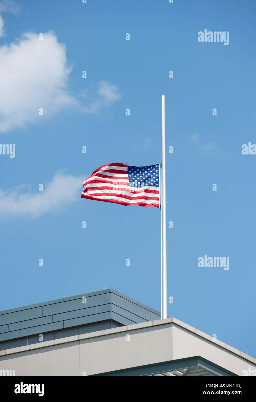 Unites States of America flag flying at half mast above American Embassy in Berlin Germany - Stock Image