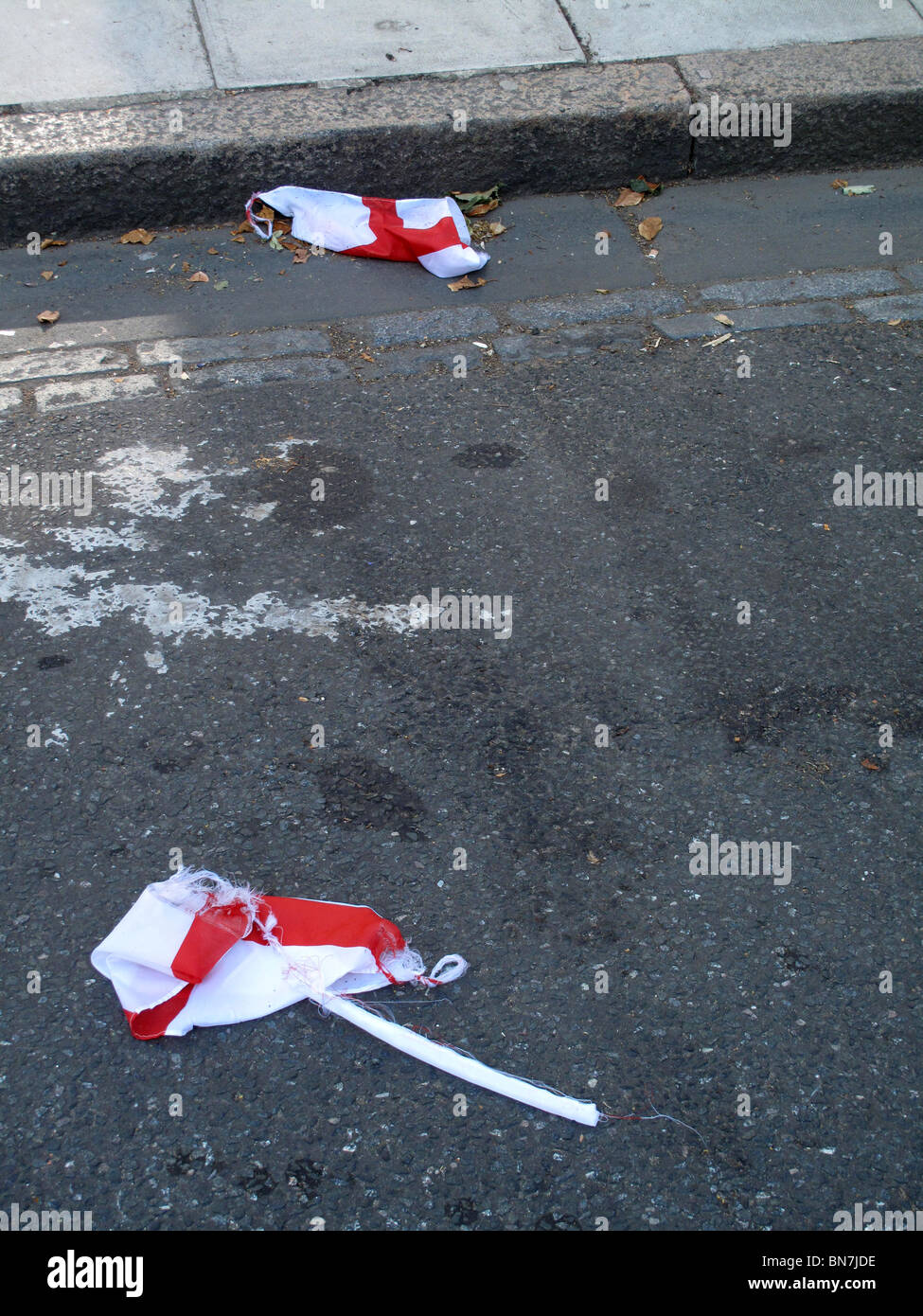 London July 2010.World cup England flags discarded in the gutter after England was defeated by Germany - Stock Image