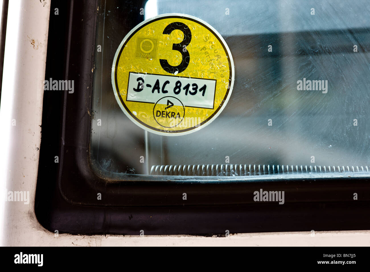 Berlin environmental zone sticker on the windshield of an off-roader. - Stock Image