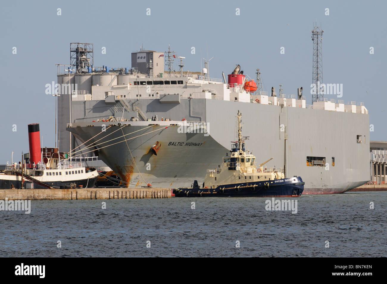 Port of Southampton the Svitzer Sussex tug and Baltic Highway moored alongside. England UK - Stock Image