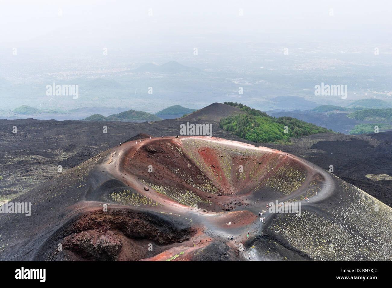 A crater near the Rifugio Sapienza on the southern slopes looking towards the coast, Mount Etna, Sicily, Italy - Stock Image